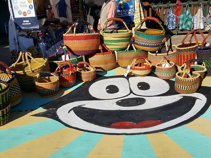 Baskets for sale at a fair trade market at Blue Arrow